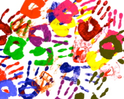 Painted handprints made from vivid acrylic paint on white paper